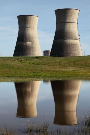 Nuclear power plant, reflection of cooling towers in foreground. photo