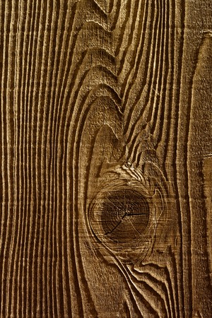 shadowed: Macro close-up of aged, weathered, sawn wood background, high relief grain, shadowed by extreme angled light. Stock Photo