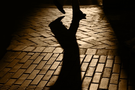 shadow: Silhouette and shadows of feet of person walking, brick pavement, San Francisco, California, Stock Photo