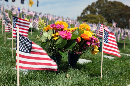 American Flags and floral display at an American National Military Cemetery Stock Photo