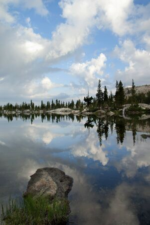 emigrant: Morning reflection of sky, clouds, trees, and granite, Wire Lakes, Emigrant Wilderness, Sierra Nevada Range, California