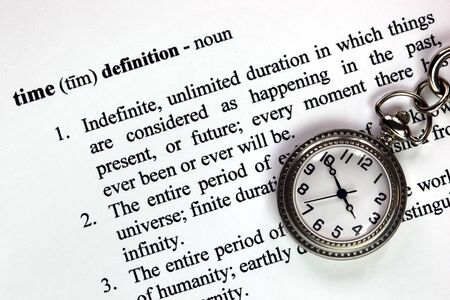 temporal: Pocket watch and definition of time, as temporal concept. Stock Photo