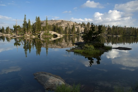 emigrant: Morning lake reflection with granite, trees, and clouds, Wire Lakes, Emigrant Wilderness, California Stock Photo