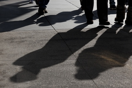 Shadows and feet of people walking along public sidewalk, San Francisco, California 版權商用圖片