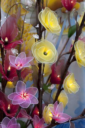illuminated: Artificial silk light-bulb flowers in illuminated arrangement.