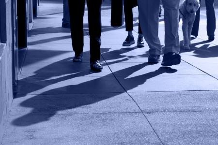 Shadows and feet of people walking along public sidewalk, San Francisco, California Stock Photo - 14062925