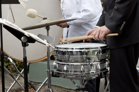 drum and bass: Drummer playing the snare drum, bass drum in background. Stock Photo