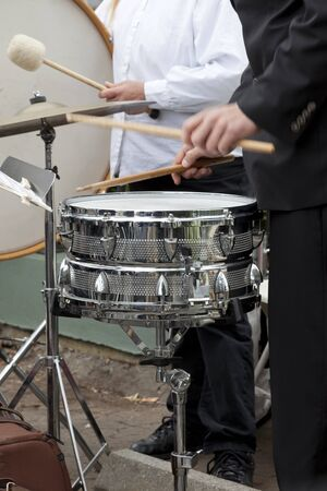 bass drum: Drummer playing the snare drum, bass drum in background. Stock Photo