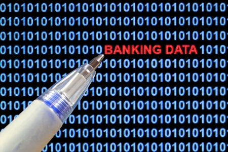 security breach: Digital binary code on computer screen, pen pointing out banking data security breach in red characters. Stock Photo
