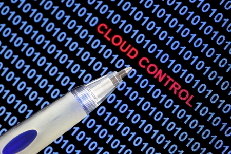 red pen: Digital binary code on computer screen, pen pointing out cloud control symbolizing cloud computing in red characters.