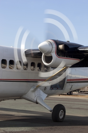 Motion blur of spinning propeller blades on turbo prop aircraft engine.