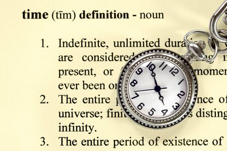 Pocket watch over definition of the word  time , applicable for any time concept or definition  Stock fotó
