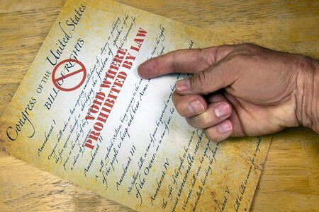 bill of rights: Hand questioning a copy of the United States Bill Of Rights ,voided by law