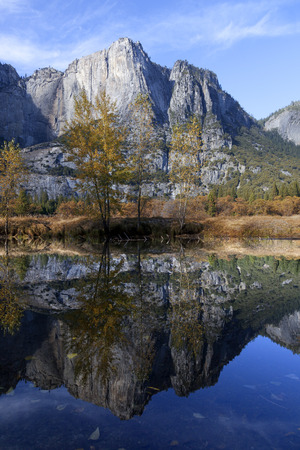 merced: Fall reflection on the Merced River, Yosemite National Park, Washington Column , perfect blue sky day. Stock Photo