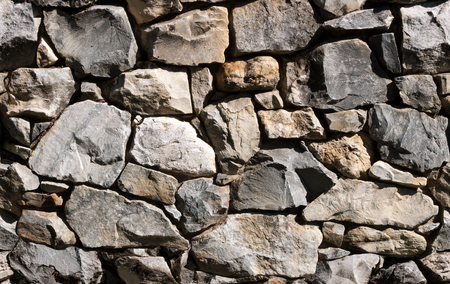 rubble: Seamless natural rubble rockwall background, use as stand alone image or as repeating tile  Stock Photo