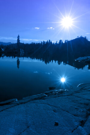 emigrant: Blue mountain lake reflection with sun, granite, trees, Emigrant Wilderness, Stanislaus National Forest, California