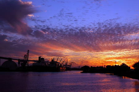 Port of Stockton and turning basin at sunset, public view from Fremont street, Stockton, California. Stock Photo