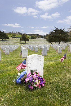 national military cemetery: Headstones, floral arrangement, and American Flags at National Military Cemetery