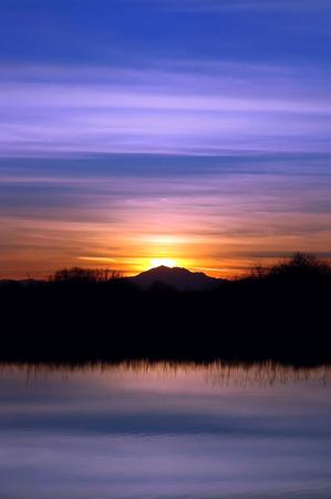 san joaquin valley: Glowing sunset behind silhouette of Mount Diablo Peak reflected in wildlife pond, San Joaquin Valley, California