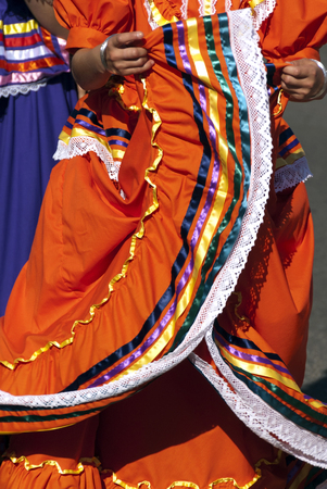 Girls dancing in traditional Mexican style Latin American costumes  Stock Photo