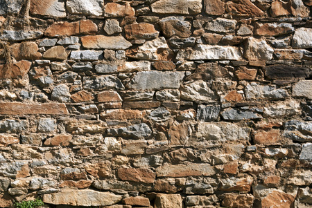 Rubble rock wall background, with quartz and limestone mining tailings, Gold Country, California