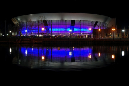 weber: Reflection of Stockton Sports Arena at night, from Weber point public park, California.