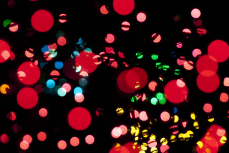 Abstract of red, yellow, blue, and green out of focus bokeh orbs.