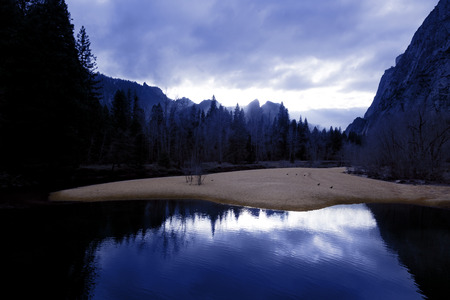 Yosemite Valley, Merced River, in deep blue silhouettes just before first Winter snowfall