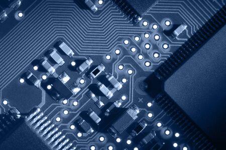 Macro of computer circuit board pattern in blue tone