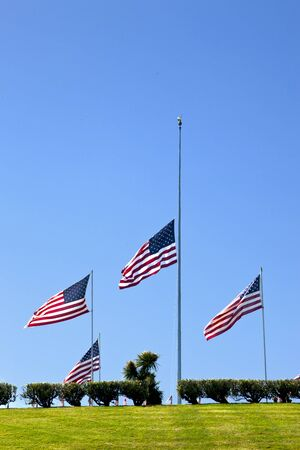 American Coffin Flags flying at half mast, United States national cemetery  Banco de Imagens
