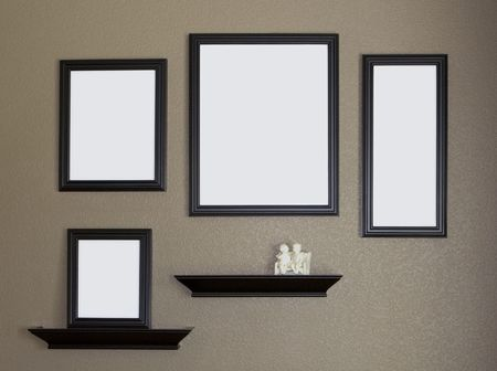 black picture frame: Collage of Blank Black Picture Frames on Brown Wall