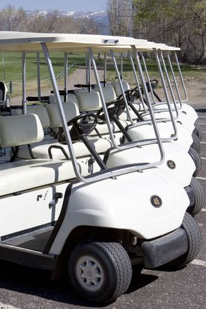 Line of Golf Carts Stock Photo
