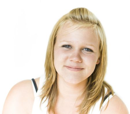 Young teenage girl looking happily into camera. Isolated on white background Stock Photo
