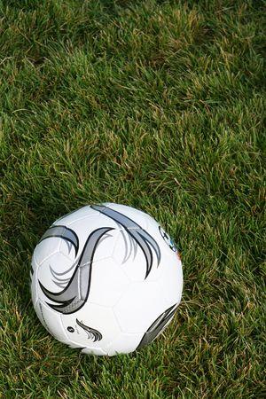 Stylized soccer ball on grass background. Stock Photo