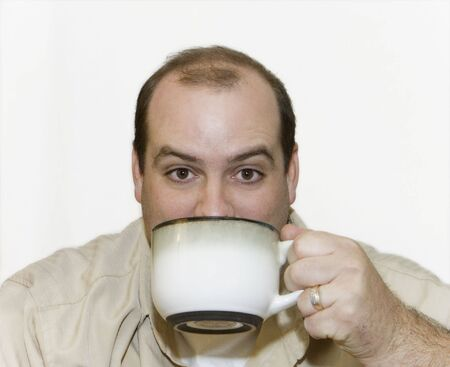 Man Drinking a Large Cup of Coffee with white background.