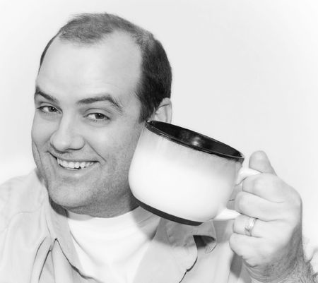 slurp: Black & White Image of Man Holding Up a Large Cup of Coffee. Stock Photo