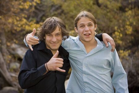 Brothers smiling and the camera and clowning around in a fall outdoor setting. Stock Photo - 3742989