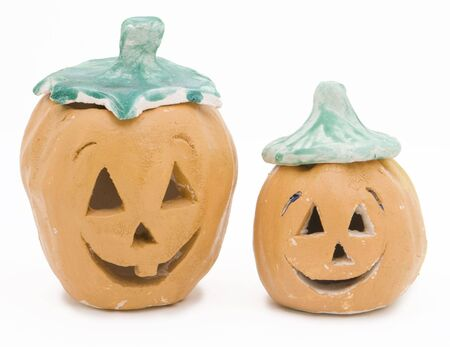 Clay Jack-o-lanterns made and painted by children.