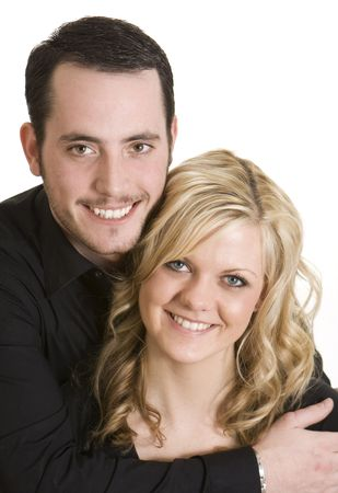 Attractive couple wearing black shirts against a white background.