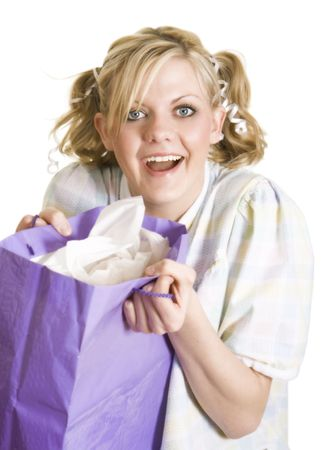 Funny image of a blonde girl with big blue eyes dressed as a little girl holding a present. Soft focus. Banque d'images