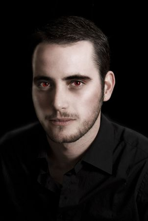Image of a young man in black manipulated to look like a vampire