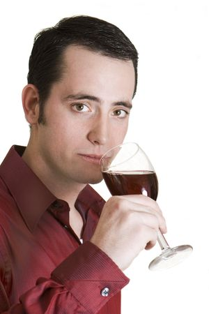 Young dark-haired man with red shirt and glass of red wine isolated on white background. photo
