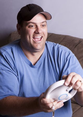 Thirty-something man playing a driving video game.