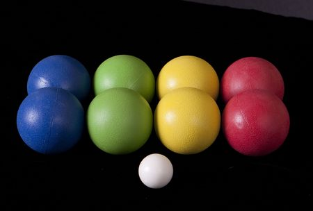 Set of colored Bocce balls on a black background. Stock Photo