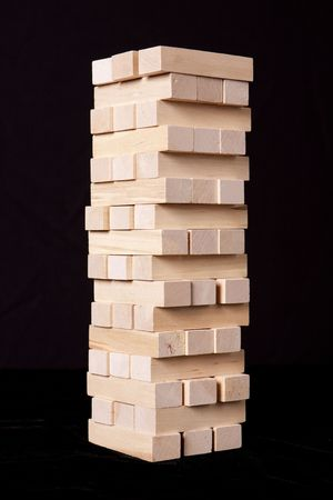 Stacked blocks against a black background.