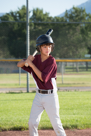 Young batter about to swing Stock Photo