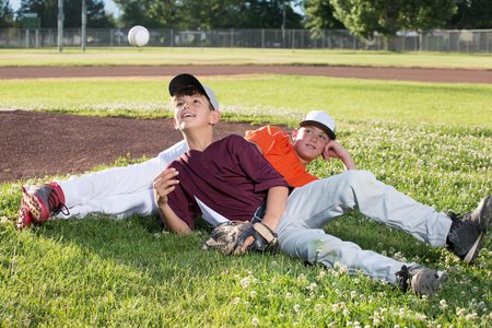 Two baseball players relaxing after game Stock Photo