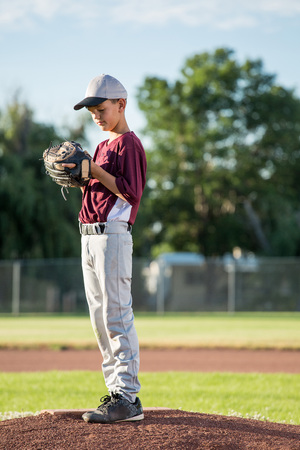 Young pitcher on baseball mound Stock Photo