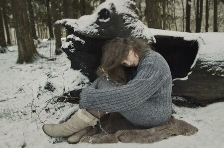 woodland  horror: girl in forest, winters tale, winter in the woods Stock Photo