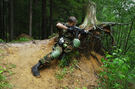 militarily: soldiers in woods